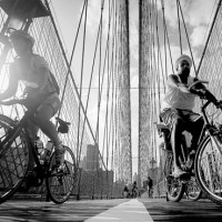Cyclists ride over the Brooklyn Bridge