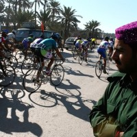 Stages of the more than 1,000-mile Tour de Pakistan take place on major highways. Above, spectators watch part of this year's race in March